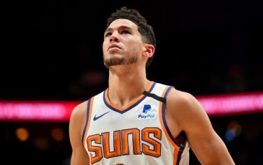 PORTLAND, OREGON - MARCH 10: Devin Booker #1 of the Phoenix Suns looks on during the first half of the game against the Portland Trail Blazers at the Moda Center on March 10, 2020 in Portland, Oregon. NOTE TO USER: User expressly acknowledges and agrees that, by downloading and or using this photograph, User is consenting to the terms and conditions of the Getty Images License Agreement. (Photo by Alika Jenner/Getty Images)