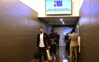 SACRAMENTO, CALIFORNIA - MARCH 11:   JJ Redick #4 of the New Orleans Pelicans walks out of the locker room to head to the bus after their game against the Sacramento Kings was postponed at Golden 1 Center on March 11, 2020 in Sacramento, California. The game was postponed because of the corona virus.  NOTE TO USER: User expressly acknowledges and agrees that, by downloading and or using this photograph, User is consenting to the terms and conditions of the Getty Images License Agreement.  (Photo by Ezra Shaw/Getty Images)