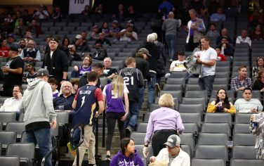 SACRAMENTO, CALIFORNIA - MARCH 11:   Fans leave the building after the Sacramento King game against the New Orleans Pelicans was postponed due to the corona virus at Golden 1 Center on March 11, 2020 in Sacramento, California. NOTE TO USER: User expressly acknowledges and agrees that, by downloading and or using this photograph, User is consenting to the terms and conditions of the Getty Images License Agreement.  (Photo by Ezra Shaw/Getty Images)