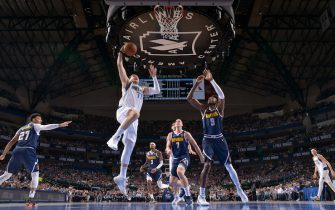 DALLAS, TX - MARCH 11: Luka Doncic #77 of the Dallas Mavericks shoots the ball against the Denver Nuggets on March 11, 2020 at the American Airlines Center in Dallas, Texas. NOTE TO USER: User expressly acknowledges and agrees that, by downloading and or using this photograph, User is consenting to the terms and conditions of the Getty Images License Agreement. Mandatory Copyright Notice: Copyright 2020 NBAE (Photo by Glenn James/NBAE via Getty Images)