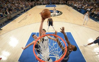 DALLAS, TX - MARCH 11: Boban Marjanovic #51 of the Dallas Mavericks dunks the ball against the Denver Nuggets on March 11, 2020 at the American Airlines Center in Dallas, Texas. NOTE TO USER: User expressly acknowledges and agrees that, by downloading and or using this photograph, User is consenting to the terms and conditions of the Getty Images License Agreement. Mandatory Copyright Notice: Copyright 2020 NBAE (Photo by Glenn James/NBAE via Getty Images)