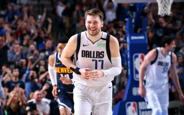 DALLAS, TX - MARCH 11: Luka Doncic #77 of the Dallas Mavericks smiles during the game against the Denver Nuggets/ on March 11, 2020 at the American Airlines Center in Dallas, Texas. NOTE TO USER: User expressly acknowledges and agrees that, by downloading and or using this photograph, User is consenting to the terms and conditions of the Getty Images License Agreement. Mandatory Copyright Notice: Copyright 2020 NBAE (Photo by Glenn James/NBAE via Getty Images)