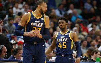 NEW ORLEANS, LOUISIANA - JANUARY 06: Donovan Mitchell #45 of the Utah Jazz and Rudy Gobert #27 talk against the New Orleans Pelicans during a game at the Smoothie King Center on January 06, 2020 in New Orleans, Louisiana. NOTE TO USER: User expressly acknowledges and agrees that, by downloading and or using this Photograph, user is consenting to the terms and conditions of the Getty Images License Agreement. (Photo by Jonathan Bachman/Getty Images)