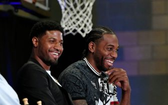 LOS ANGELES, CA - JULY 24: Kawhi Leonard (R) and Paul George laugh as they listen to Los Angeles Clippers owner Steve Ballmer speak (not in frame) during their introductory news conference at Green Meadows Recreation Center on July 24, 2019 in Los Angeles, California. NOTE TO USER: User expressly acknowledges and agrees that, by downloading and or using this photograph, User is consenting to the terms and conditions of the Getty Images License Agreement. at Green Meadows Recreation Center on July 24, 2019 in Los Angeles, California. (Photo by Kevork Djansezian/Getty Images)