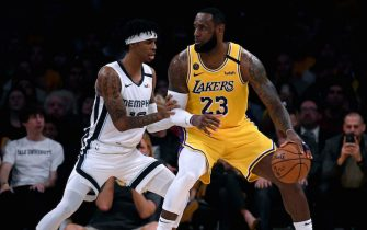 LOS ANGELES, CALIFORNIA - FEBRUARY 21:  LeBron James #23 of the Los Angeles Lakers posts up Ja Morant #12 of the Memphis Grizzlies during the third quarter at Staples Center on February 21, 2020 in Los Angeles, California.  NOTE TO USER: User expressly acknowledges and agrees that, by downloading and or using this photograph, User is consenting to the terms and conditions of the Getty Images License Agreement. (Photo by Harry How/Getty Images)