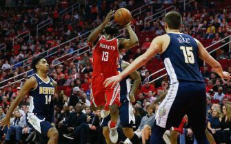HOUSTON, TX - NOVEMBER 22:  James Harden #13 of the Houston Rockets shoots over Nikola Jokic #15 of the Denver Nuggets and Gary Harris #14 at Toyota Center on November 22, 2017 in Houston, Texas. NOTE TO USER: User expressly acknowledges and agrees that, by downloading and or using this photograph, User is consenting to the terms and conditions of the Getty Images License Agreement.  (Photo by Bob Levey/Getty Images)