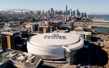 """Chase Center, home to the Golden State Warriors, is seen from above in San Francisco California on March 12, 2020. - The NBA suspended its season after a Utah Jazz player tested positive Wednesday for the coronavirus. NBA commissioner Adam Silver said March 12, 2020, the league shut-down because of the coronavirus pandemic is likely to last """"at least 30 days"""". That would see the league shuttered through what would have been about the last month of its regular season. (Photo by Josh Edelson / AFP) (Photo by JOSH EDELSON/AFP via Getty Images)"""