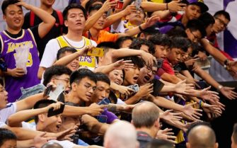 Fans reach out to players after the National Basketball Association (NBA) pre-season game between the Los Angeles Lakers and Brooklyn Nets in Shenzhen, in China's southern Guangdong province on October 12, 2019. (Photo by STR / AFP) / China OUT (Photo by STR/AFP via Getty Images)
