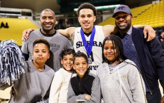 LONG BEACH, CA - MARCH 17:  Duane Washington Jr. (Top Middle) of the Sierra Canyon Trailblazers poses with his uncle Derek Fisher (Top Right) and other family members after their victory against the Etiwanda Eagles for the CIF State Regional Finals on March 17, 2018 in Long Beach, California.  (Photo by Cassy Athena/Getty Images)
