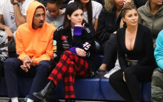 CHATSWORTH, CA - MARCH 09:  (L-R) (Top) Kim Kardashian (Bottom) Taco Bennett, Kendall Jenner and Larsa Younan watch courtside as Sierra Canyon plays Foothills Christian for the CIF Open Division Playoffs at Sierra Canyon High School on March 9, 2018 in Chatsworth, California.  (Photo by Cassy Athena/Getty Images)