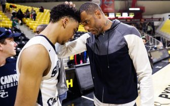 LONG BEACH, CA - MARCH 17:  Kenyon Martin Jr. (L) of the Sierra Canyon Trailblazers shares a moment with his father, Kenyon Martin Sr. (R), after their victory against the against the Etiwanda Eagles for the CIF State Regional Finals on March 17, 2018 in Long Beach, California.  (Photo by Cassy Athena/Getty Images)