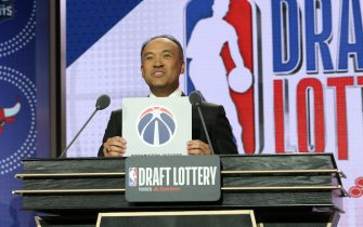 CHICAGO, IL - MAY 14: Deputy Commissioner of the NBA, Mark Tatum, holds up the card for the Washington Wizards after they get the 9th overall pick in the NBA Draft during the 2019 NBA Draft Lottery on May 14, 2019 at the Chicago Hilton in Chicago, Illinois. NOTE TO USER: User expressly acknowledges and agrees that, by downloading and/or using this photograph, user is consenting to the terms and conditions of the Getty Images License Agreement. Mandatory Copyright Notice: Copyright 2019 NBAE (Photo by Gary Dineen/NBAE via Getty Images)