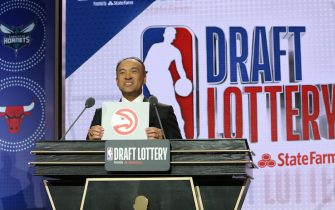 CHICAGO, IL - MAY 14: Deputy Commissioner of the NBA, Mark Tatum, holds up the card for the Atlanta Hawks after they get the10th overall pick in the NBA Draft during the 2019 NBA Draft Lottery on May 14, 2019 at the Chicago Hilton in Chicago, Illinois. NOTE TO USER: User expressly acknowledges and agrees that, by downloading and/or using this photograph, user is consenting to the terms and conditions of the Getty Images License Agreement. Mandatory Copyright Notice: Copyright 2019 NBAE (Photo by Gary Dineen/NBAE via Getty Images)