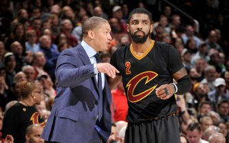 CLEVELAND, OH - DECEMBER 29:  Heac Coach Tyronn Lue of the Cleveland Cavaliers gives instructions to Kyrie Irving #2 during a game against the Boston Celtics on December 29, 2016 at Quicken Loans Arena in Cleveland, Ohio. NOTE TO USER: User expressly acknowledges and agrees that, by downloading and/or using this photograph, user is consenting to the terms and conditions of the Getty Images License Agreement. Mandatory Copyright Notice: Copyright 2016 NBAE (Photo by David Liam Kyle/NBAE via Getty Images)