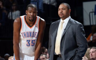 OKLAHOMA CITY, OK - JANUARY 17: Kevin Durant #35 of the Oklahoma City Thunder and Mark Jackson, head coach of the Golden State Warriors during an NBA game on January 17, 2014 at the Chesapeake Energy Arena in Oklahoma City, Oklahoma. NOTE TO USER: User expressly acknowledges and agrees that, by downloading and or using this Photograph, user is consenting to the terms and conditions of the Getty Images License Agreement. Mandatory Copyright Notice: Copyright 2014 NBAE (Photo by Layne Murdoch/NBAE via Getty Images)