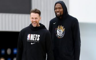 BROOKLYN, NY - OCTOBER 1: Assistant coach Adam Harrington and Kevin Durant #7 of the Brooklyn Nets smile during practice on October 1, 2019 at HSS Training Center in Brooklyn, New York. NOTE TO USER: User expressly acknowledges and agrees that, by downloading and or using this Photograph, user is consenting to the terms and conditions of the Getty Images License Agreement. Mandatory Copyright Notice: Copyright 2019 NBAE (Photo by Nathaniel S. Butler/NBAE via Getty Images)