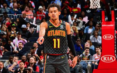 ATLANTA, GA - MARCH 9: Trae Young #11 of the Atlanta Hawks reacts to a play during the game against the Charlotte Hornets on March 9, 2020 at State Farm Arena in Atlanta, Georgia.  NOTE TO USER: User expressly acknowledges and agrees that, by downloading and/or using this Photograph, user is consenting to the terms and conditions of the Getty Images License Agreement. Mandatory Copyright Notice: Copyright 2020 NBAE (Photo by Scott Cunningham/NBAE via Getty Images)