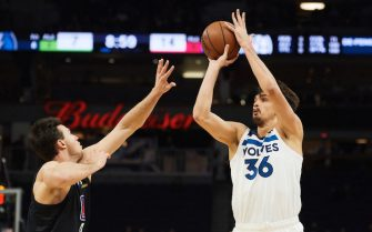 MINNEAPOLIS, MN - MARCH 26: Dario Saric #36 of the Minnesota Timberwolves shoots the ball against Danilo Gallinari #8 of the LA Clippers during the game on March 26, 2019 at the Target Center in Minneapolis, Minnesota. NOTE TO USER: User expressly acknowledges and agrees that, by downloading and or using this Photograph, user is consenting to the terms and conditions of the Getty Images License Agreement. (Photo by Hannah Foslien/Getty Images)