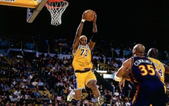 INGLEWOOD, CA - 1999:  Dennis Rodman #73 of the Los Angeles Lakers grabs a rebound against Terry Cummings #35 of the Golden State Warriors during a 1999 NBA game at the Great Western Forum in Inglewood, California.  NOTE TO USER: User expressly acknowledges that, by downloading and or using this photograph, User is consenting to the terms and conditions of the Getty Images License agreement. Mandatory Copyright Notice: Copyright 1999 NBAE (Photo by Garrett Ellwood/NBAE via Getty Images)