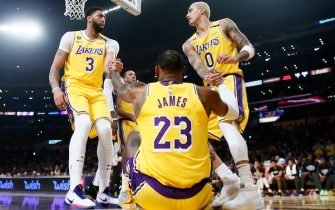 LOS ANGELES, CA - FEBRUARY 10: Anthony Davis #3 and Kyle Kuzma #0 help up LeBron James #23 of the Los Angeles Lakers during the game against the Phoenix Suns at the Staples Center on February 10, 2020 in Los Angeles, CA. NOTE TO USER: User expressly acknowledges and agrees that, by downloading and or using this photograph, User is consenting to the terms and conditions of the Getty Images License Agreement. Mandatory Credit: 2020 NBAE (Photo by Chris Elise/NBAE via Getty Images)