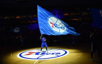 PHILADELPHIA, PA - JANUARY 10: A member of the Philadelphia 76ers dance team holds the team flag logo against the Indiana Pacers at Wells Fargo Center on January 10, 2015 in Philadelphia, Pennsylvania NOTE TO USER: User expressly acknowledges and agrees that, by downloading and/or using this Photograph, user is consenting to the terms and conditions of the Getty Images License Agreement. Mandatory Copyright Notice: Copyright 2015 NBAE (Photo by Jesse D. Garrabrant/NBAE via Getty Images)