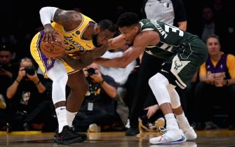 LOS ANGELES, CALIFORNIA - MARCH 06:  LeBron James #23 of the Los Angeles Lakers is guarded by Giannis Antetokounmpo #34 of the Milwaukee Bucks during the third quarter at Staples Center on March 06, 2020 in Los Angeles, California.  NOTE TO USER: User expressly acknowledges and agrees that, by downloading and or using this photograph, User is consenting to the terms and conditions of the Getty Images License Agreement.  (Photo by Harry How/Getty Images)