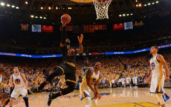 OAKLAND, CA - JUNE 13:  LeBron James #23 of the Cleveland Cavaliers goes up for the layup against the Golden State Warriors during the 2016 NBA Finals Game Five on June 13, 2016 at ORACLE Arena in Oakland, California. NOTE TO USER: User expressly acknowledges and agrees that, by downloading and or using this photograph, User is consenting to the terms and conditions of the Getty Images License Agreement. Mandatory Copyright Notice: Copyright 2016 NBAE (Photo by Jesse D. Garrabrant/NBAE via Getty Images)