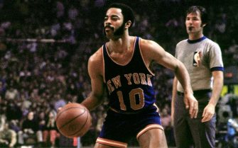BOSTON - 1973:  Walt Frazier #10 of the New York Knicks moves the ball up court against the Boston Celtics during the Eastern Conference Finals played in 1973 at the Boston Garden in Boston, Massachusetts. NOTE TO USER: User expressly acknowledges and agrees that, by downloading and or using this photograph, User is consenting to the terms and conditions of the Getty Images License Agreement. Mandatory Copyright Notice: Copyright 1973 NBAE (Photo by Dick Raphael/NBAE via Getty Images)