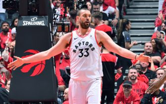 TORONTO, CANADA - JUNE 2: Marc Gasol #33 of the Toronto Raptors high fives his teammates during Game Two of the NBA Finals against the Golden State Warriors on June 2, 2019 at Scotiabank Arena in Toronto, Ontario, Canada. NOTE TO USER: User expressly acknowledges and agrees that, by downloading and/or using this photograph, user is consenting to the terms and conditions of the Getty Images License Agreement. Mandatory Copyright Notice: Copyright 2019 NBAE (Photo by Jesse D. Garrabrant/NBAE via Getty Images)