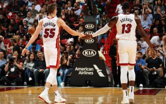 MIAMI, FL - JANUARY 15: Duncan Robinson #55 of the Miami Heat and Bam Adebayo #13 high five during the game against the San Antonio Spurs on January 15, 2020 at American Airlines Arena in Miami, Florida. NOTE TO USER: User expressly acknowledges and agrees that, by downloading and or using this Photograph, user is consenting to the terms and conditions of the Getty Images License Agreement. Mandatory Copyright Notice: Copyright 2020 NBAE (Photo by Oscar Baldizon/NBAE via Getty Images)