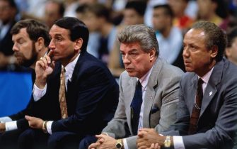 BARCELONA, SPAIN - 1992:  USA Men's National Basketball coaching staff (L-R) P.J. Carlisimo, Mike Krzyzewski, Chuck Daly and Lenny Wilkins look on from the bench during the 1992 Olympics in Barcelona, Spain.  NOTE TO USER: User expressly acknowledges and agrees that, by downloading and or using this photograph, User is consenting to the terms and conditions of the Getty Images License Agreement. Mandatory Copyright Notice: Copyright 1992 NBAE (Photo by Andrew D. Bernstein/NBAE via Getty Images)