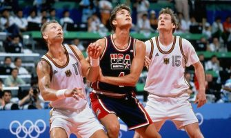 BARCELONA - 1992: Christian Laettner #4 of the United States boxes out against Detlef Schrempf #11 of Germany during the 1992 Olympics in Barcelona, Spain.  NOTE TO USER: User expressly acknowledges that, by downloading and or using this photograph, User is consenting to the terms and conditions of the Getty Images License agreement. Mandatory Copyright Notice: Copyright 1992 NBAE (Photo by Andrew D. Bernstein/NBAE via Getty Images)