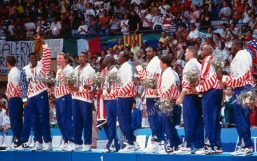 BARCELONA, SPAIN- AUGUST 8: The United States stands on the podium following the Gold Medal Basketball game between the United States and Croatia at the 1992 Olympics on August 8 1992 at the Palau Municipal d'Esports de badalona in Barcelona, Spain. The United States defeated Croatia 117-85 to win the gold medal. NOTE TO USER: User expressly acknowledges and agrees that, by downloading and or using this photograph, User is consenting to the terms and conditions of the Getty Images License Agreement. Mandatory Copyright Notice: Copyright 1992 NBAE (Photo by Andrew D. Bernstein/NBAE via Getty Images)