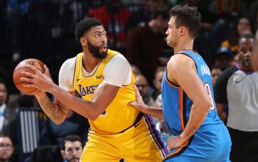 OKLAHOMA CITY, OK - NOVEMBER 22: Anthony Davis #3 of the Los Angeles Lakers handles the ball against Danilo Gallinari #8 of the Oklahoma City Thunder on November 22, 2019 at Chesapeake Energy Arena in Oklahoma City, Oklahoma. NOTE TO USER: User expressly acknowledges and agrees that, by downloading and or using this photograph, User is consenting to the terms and conditions of the Getty Images License Agreement. Mandatory Copyright Notice: Copyright 2019 NBAE (Photo by Joe Murphy/NBAE via Getty Images)