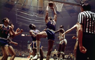NEW YORK - 1970: Wilt Chamberlain #13 of the Philadelphia 76'ers goes for a dunk against the New York Knicks during the NBA game at Madison Square Garden in New York. NOTE TO USER: User expressly acknowledges  and agrees that, by downloading and or using this  photograph, User is consenting to the terms and conditions of the Getty Images License Agreement. (Photo by Walter Iooss Jr./ NBAE/ Getty Images)
