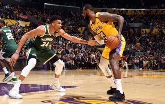 LOS ANGELES, CA - MARCH 6: LeBron James #23 of the Los Angeles Lakers handles the ball while Giannis Antetokounmpo #34 of the Milwaukee Bucks plays defense during the game on March 6, 2020 at STAPLES Center in Los Angeles, California. NOTE TO USER: User expressly acknowledges and agrees that, by downloading and/or using this Photograph, user is consenting to the terms and conditions of the Getty Images License Agreement. Mandatory Copyright Notice: Copyright 2020 NBAE (Photo by Andrew D. Bernstein/NBAE via Getty Images)