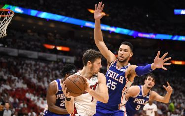 MIAMI, FL - APRIL 21: Ben Simmons #25 of the Philadelphia 76ers defends Goran Dragic #7 of the Miami Heat in the third quarter during Game Four of Round One of the 2018 NBA Playoffs at American Airlines Arena on April 21, 2018 in Miami, Florida. NOTE TO USER: User expressly acknowledges and agrees that, by downloading and or using this photograph, User is consenting to the terms and conditions of the Getty Images License Agreement. (Photo by Mark Brown/Getty Images)
