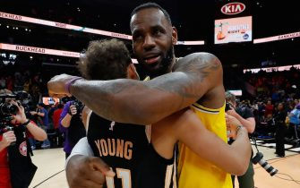 ATLANTA, GEORGIA - DECEMBER 15:  LeBron James #23 of the Los Angeles Lakers hugs Trae Young #11 of the Atlanta Hawks at State Farm Arena on December 15, 2019 in Atlanta, Georgia.  NOTE TO USER: User expressly acknowledges and agrees that, by downloading and/or using this photograph, user is consenting to the terms and conditions of the Getty Images License Agreement.  (Photo by Kevin C. Cox/Getty Images)