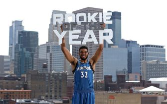 MINNEAPOLIS, MN - MAY 13:  Karl-Anthony Towns #32 of the Minnesota Timberwolves poses with the Eddie Gottlieb trophy in preparation for his being named the 2015- 2016 Kia NBA Rookie of the Year on May 13, 2016 in Minneapolis, Minnesota.  NOTE TO USER: User expressly acknowledges and agrees that, by downloading and or using this Photograph, user is consenting to the terms and conditions of the Getty Images License Agreement. Mandatory Copyright Notice: Copyright 2016 NBAE (Photo by David Sherman/NBAE via Getty Images)