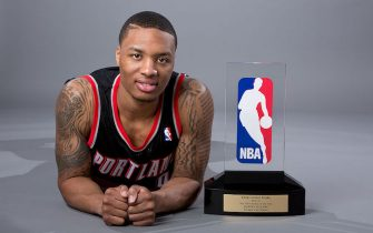PORTLAND, OR - MAY 1: Damian Lillard #0 of the Portland Trail Blazers poses with the Eddie Gottlieb Trophy after winning the 2012-2013 Kia NBA Rookie of the Year award on May 1, 2013 at the Rose Garden Arena in Portland, Oregon. NOTE TO USER: User expressly acknowledges and agrees that, by downloading and or using this photograph, user is consenting to the terms and conditions of the Getty Images License Agreement. Mandatory Copyright Notice: Copyright 2013 NBAE (Photo by Sam Forencich/NBAE via Getty Images)