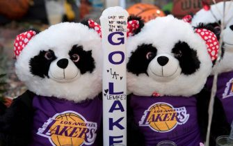 Panda Bear Lakers fans at a Staples Center memorial to NBA legend Kobe Bryant, who was killed last weekend in a helicopter accident, in Los Angeles, California on January 31, 2020. (Photo by Mark RALSTON / AFP) (Photo by MARK RALSTON/AFP via Getty Images)