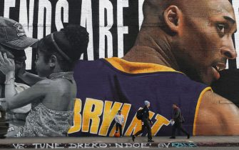 LOS ANGELES, CALIFORNIA - FEBRUARY 13: A mural depicting deceased NBA star Kobe Bryant and his 13-year-old daughter Gianna, painted by Royyaldog, is displayed on a building on February 13, 2020 in Los Angeles, California. Numerous murals depicting Bryant and Gianna have been created around greater Los Angeles following their tragic deaths in a helicopter crash which left a total of nine dead. A public memorial service honoring Bryant will be held February 24 at the Staples Center in Los Angeles, where Bryant played most of his career with the Los Angeles Lakers.  (Photo by Mario Tama/Getty Images)