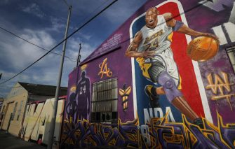LOS ANGELES, CALIFORNIA - FEBRUARY 13: A mural depicting deceased NBA star Kobe Bryant and his 13-year-old daughter Gianna, painted by @theoneplek and @tetriswai, is displayed on a building on February 13, 2020 in Los Angeles, California. Numerous murals depicting Bryant and Gianna have been created around greater Los Angeles following their tragic deaths in a helicopter crash which left a total of nine dead. A public memorial service honoring Bryant will be held February 24 at the Staples Center in Los Angeles, where Bryant played most of his career with the Los Angeles Lakers.  (Photo by Mario Tama/Getty Images)