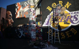 LOS ANGELES, CALIFORNIA - FEBRUARY 14: A mural depicting deceased NBA star Kobe Bryant is painted by @gz.jr on a building on February 14, 2020 in Los Angeles, California. Numerous murals depicting Bryant have been created around greater Los Angeles following their tragic deaths in a helicopter crash which left a total of nine dead. A public memorial service honoring Bryant will be held February 24 at the Staples Center in Los Angeles, where Bryant played most of his career with the Los Angeles Lakers.  (Photo by Mario Tama/Getty Images)