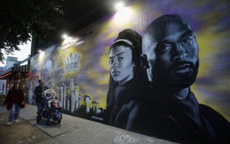 LOS ANGELES, CALIFORNIA - FEBRUARY 14: A mural depicting deceased NBA star Kobe Bryant and his daughter Gianna, painted by @hijackart, is displayed along a sidewalk on February 14, 2020 in Los Angeles, California. Numerous murals depicting Bryant and Gianna have been created around greater Los Angeles following their tragic deaths in a helicopter crash which left a total of nine dead. A public memorial service honoring Bryant will be held February 24 at the Staples Center in Los Angeles, where Bryant played most of his career with the Los Angeles Lakers.  (Photo by Mario Tama/Getty Images)