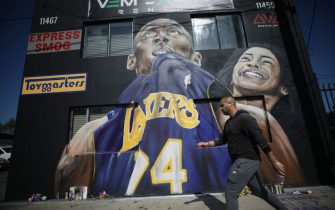 LOS ANGELES, CALIFORNIA - FEBRUARY 13: A mural depicting deceased NBA star Kobe Bryant and his daughter Gianna, painted by Artoon, is displayed on a building on February 13, 2020 in Los Angeles, California. Numerous murals depicting Bryant and Gianna have been created around greater Los Angeles following their tragic deaths in a helicopter crash which left a total of nine dead. A public memorial service honoring Bryant will be held February 24 at the Staples Center in Los Angeles, where Bryant played most of his career with the Los Angeles Lakers.  (Photo by Mario Tama/Getty Images)