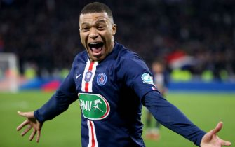 LYON, FRANCE - MARCH 4: Kylian Mbappe of PSG celebrates his third goal during the French Cup semifinal match between Olympique Lyonnais (OL) and Paris Saint-Germain (PSG) at Groupama Stadium on March 4, 2020 in Decines near Lyon, France. (Photo by Jean Catuffe/Getty Images)