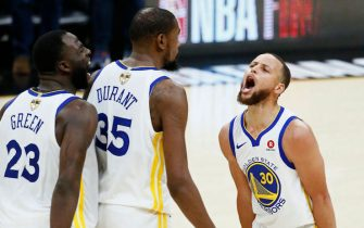 CLEVELAND, OH - JUNE 6: Draymond Green #23 and Stephen Curry #30 react in Kevin Durant #35 of the Golden State Warriors face after scoring against the Cleveland Cavaliers in Game Three of the 2018 NBA Finals on June 6, 2018 at Quicken Loans Arena in Cleveland, Ohio. NOTE TO USER: User expressly acknowledges and agrees that, by downloading and/or using this photograph, user is consenting to the terms and conditions of the Getty Images License Agreement. Mandatory Copyright Notice: Copyright 2018 NBAE (Photo by Chris Elise/NBAE via Getty Images)