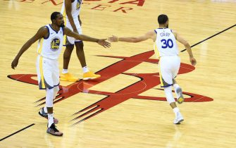 HOUSTON, TX - MAY 28: Kevin Durant #35 and Stephen Curry #30 of the Golden State Warriors high five in Game Seven of the Western Conference Finals against the Houston Rockets during the 2018 NBA Playoffs on May 28, 2018 at the Toyota Center in Houston, Texas. NOTE TO USER: User expressly acknowledges and agrees that, by downloading and/or using this photograph, user is consenting to the terms and conditions of the Getty Images License Agreement. Mandatory Copyright Notice: Copyright 2018 NBAE (Photo by Noah Graham/NBAE via Getty Images)