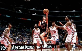 LOS ANGELES - 2000:  John Stockton #12 of the Utah Jazz goes in for a layup during a 2000 season NBA game against the Los Angeles Clippers at the Staples Center in Los Angeles, California.  NOTE TO USER: User expressly acknowledges and agrees that, by downloading and/or using this Photograph, User is consenting to the terms and conditions of the Getty Images License Agreement  Copyright 2000 NBAE  (Photo by Atiba Jefferson/NBAE via Getty Images)